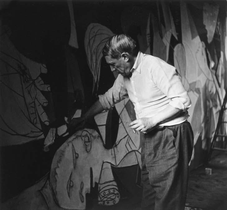 Picasso working on Guernica in his studio at Grands-Augustins, Paris (1937), Dora Maar.