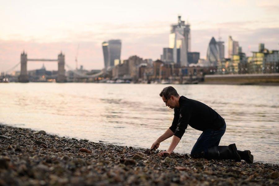 Bank vault: mudlarker Jason Sandy on the foreshore of the River Thames.