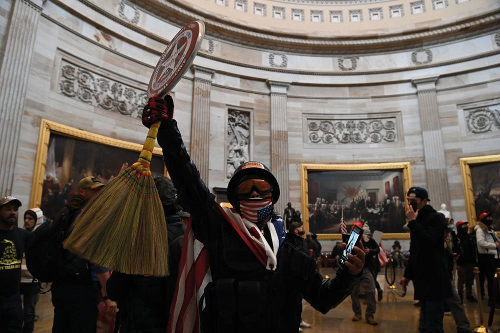 Selfie harm: rioters in the US Capitol rotunda on January 2021.