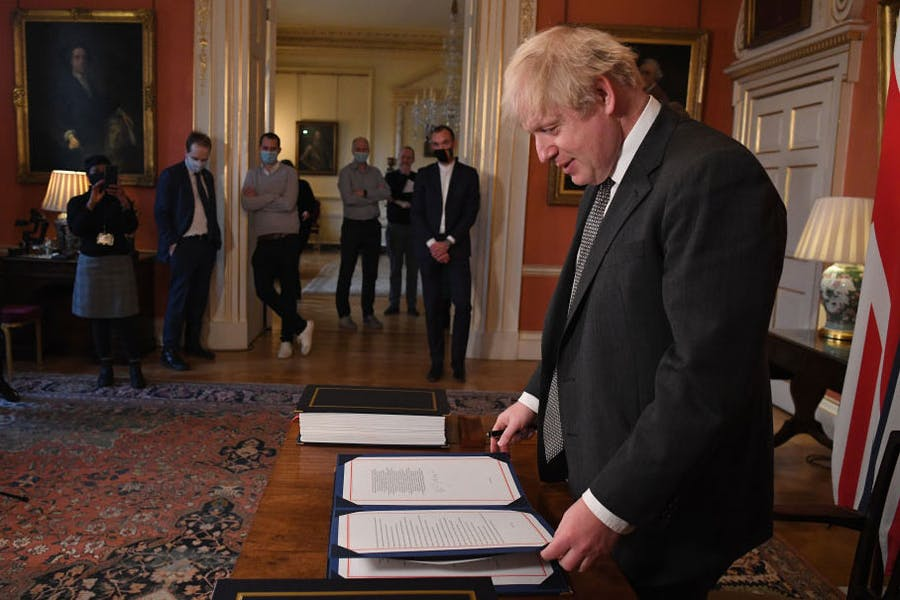 No more red tape? Boris Johnson signs the Brexit deal in December 2020.