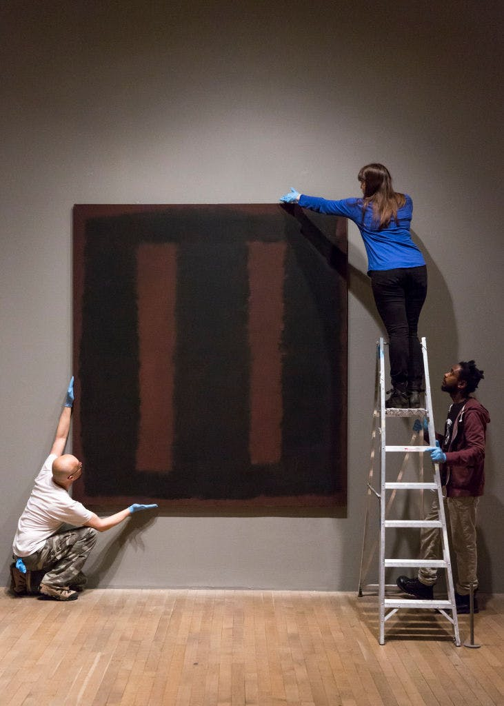 One of Mark Rothko's Black On Maroon paintings from 1958 being installed at Tate Modern, London (they currently hang in Tate Britain).