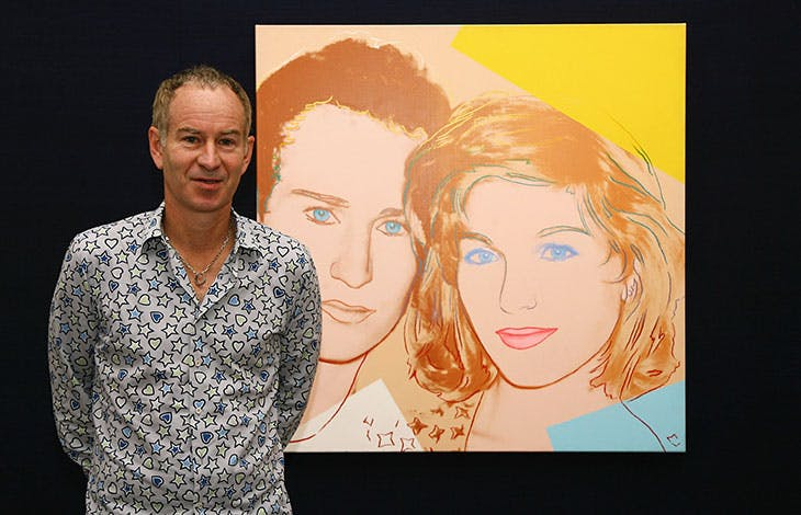 Double vision: John McEnroe standing in front of Andy Warhol's 1986 portrait of McEnroe and Tatum O'Neil from 1986.