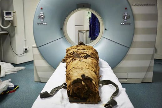 An ancient Egyptian mummy, Nesyamun, laid on the couch to be CT scanned at Leeds General Infirmary.