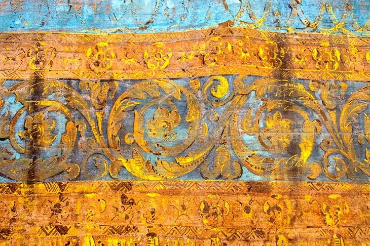 The original 18th-century stage curtain, painted to imitate gold-embroidered blue velvet