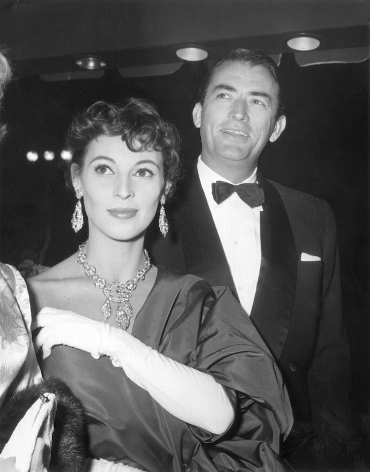 Véronique and Gregory Peck and his wife at the premiere of director Nunnally Johnson's film, 'The Man in the Gray Flannel Suit' (1956).