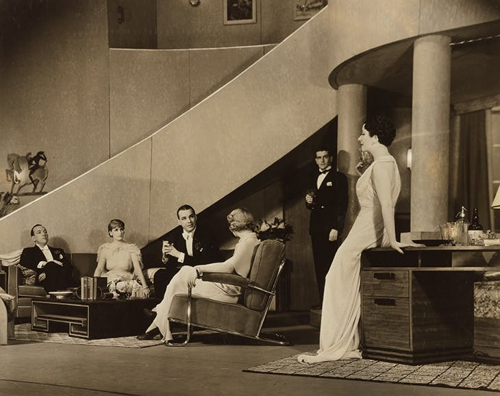 Noél Coward (far left), Ethel Borden, Alfred Lunt, Gladys Henson, Alan Campbell and Lynn Fontanne in the original Broadway production of Design for Living in 1953, with sets designed by Gladys Calthrop.
