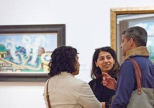 Visitors in conversation at the National Gallery of Art, Washington, D.C.