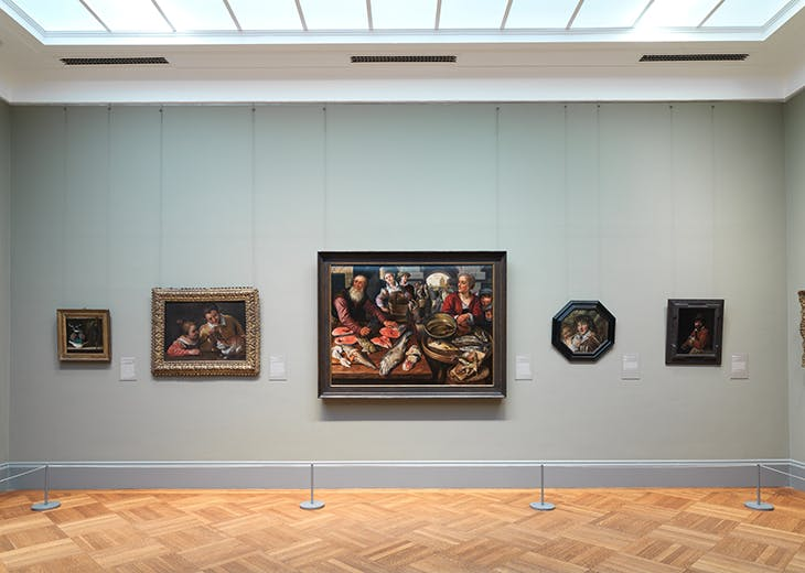 Installation view of Gallery 627, dedicated to still lifes, including Joachim Beuckelaer's Fish Market and works by Clara Peeters and Orsola Maddalena Caccia.