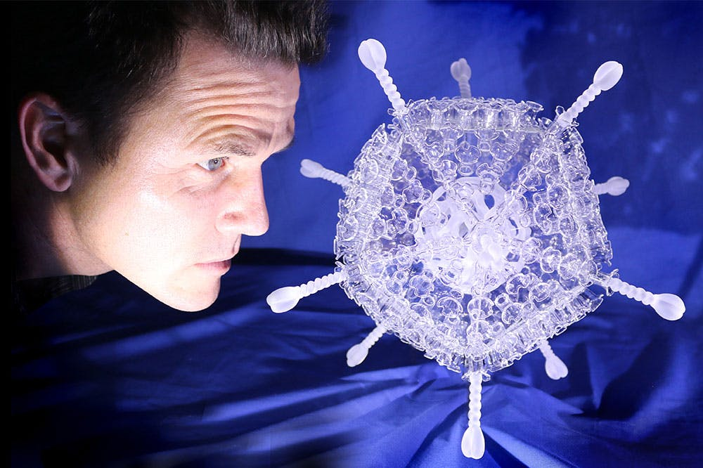 A dose of culture: Luke Jerram with his Oxford/AstraZeneca vaccine sculpture
