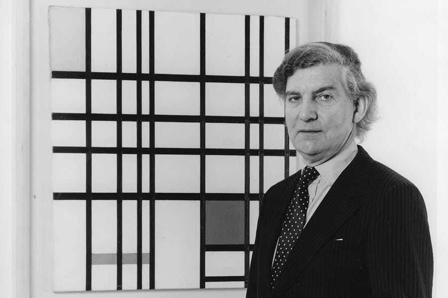 Alan Bowness with Piet Mondrian's Composition with Yellow, Blue and Red at the Tate, 1980