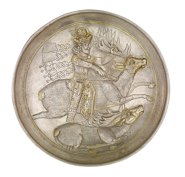 Plate with king with the crown of Shabuhr II slaying a stag (c. late 4th century), Sasanian, Iran. British Museum, London