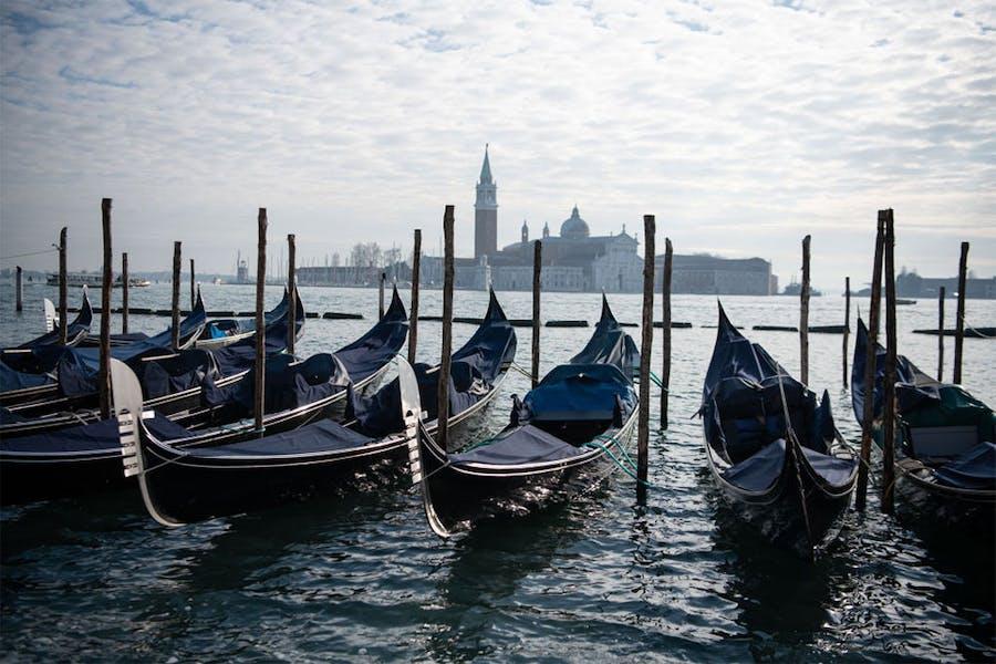 In hibernation: covered gondolas line the shore in Venice in December 2020.
