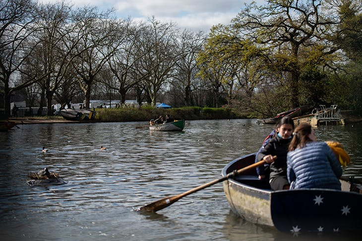 Boaters on the lake in Finsbury Park, 2 April 2021. Photo: Chris J Ratcliffe/Getty Images