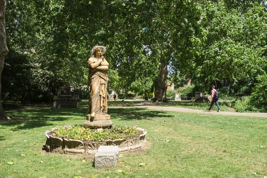 Terracotta statue of Euterpe, the Muse of instrumental music, in St George's Gardens, Bloomsbury.