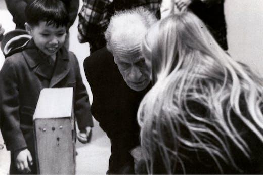 Joseph Cornell with visitors to 'A Joseph Cornell Exhibition for Children' at the Cooper Union, New York in 1972. Photo: Denise Hare