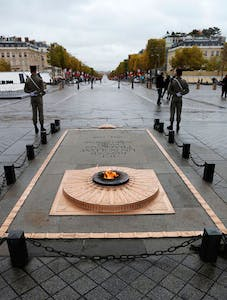 The eternal flame at the Tomb of the Unknown Soldier beneath the Arc de Triomphe, on Armistice Day, 11 November 2017.