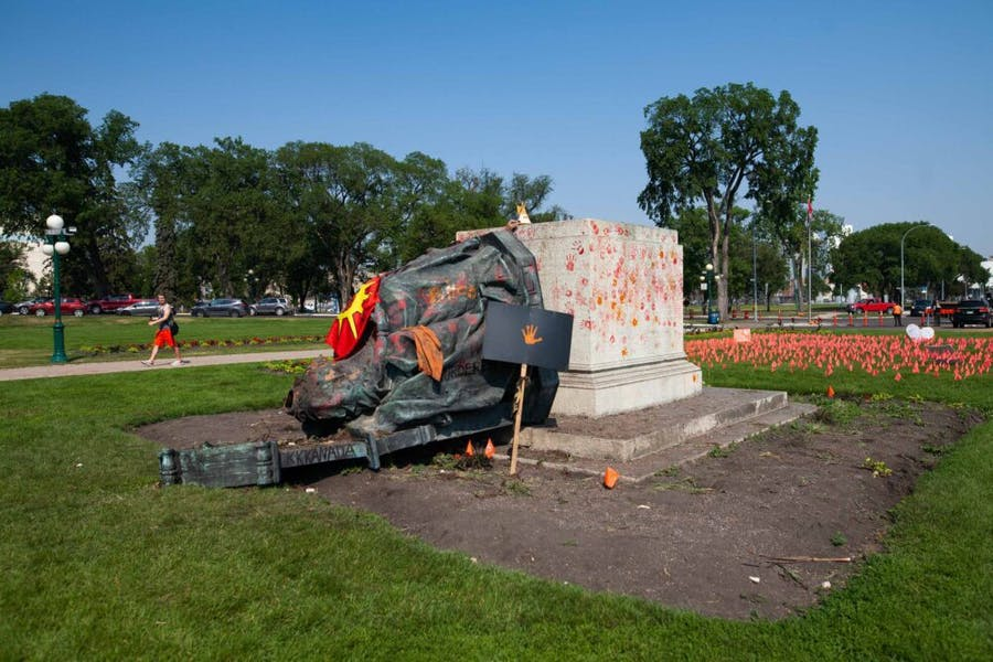 A toppled statue of Queen Victoria on the grounds of the Manitoba Legislature on 2 July, 2021 in Winnipeg, Manitoba, Canada. The statue was pulled down by indigenous protestors following a march to honour survivors and victims of Canada's residential school system.