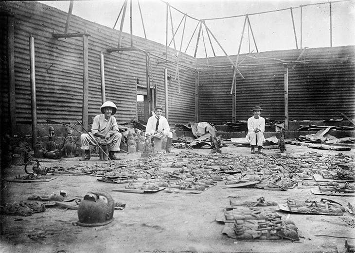 Soldiers with the British punitive expedition of February 1897 photographed by Reginald Granville Kerr in the Benin palace compound, Benin City, in 1897.