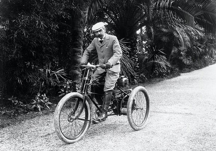 Baron Pierre de Coubertin, photographed on a motor tricycle in the south of France.