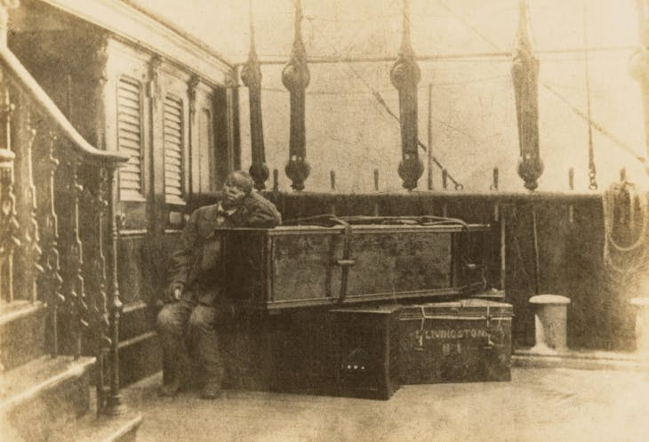 Jacob Wainwright with David Livingstone's body and some of his traveling trunks on board the ship Malwai.