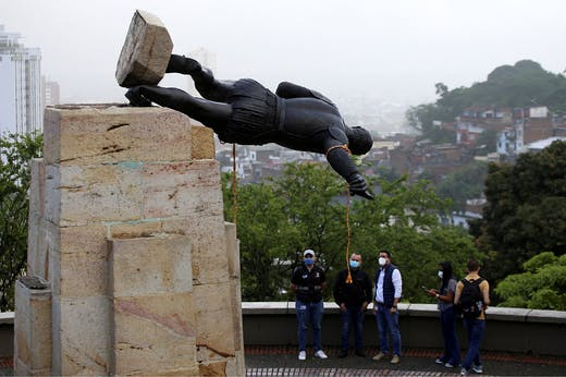 The statue of Sebástian de Belalcázar being toppled in Cali, Colombia on 28 April 2021.
