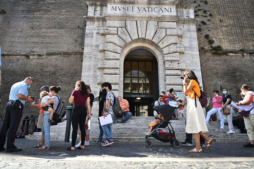 Visitors showing their 'green pass' at the Vatican Museums in August 2021.
