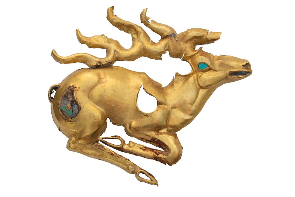Gold recumbent stag plaque with inlays of turquoise and lapis lazuli (eighth–sixth century BC), discovered at the Eleke Sazy burial complex in Kazakhstan