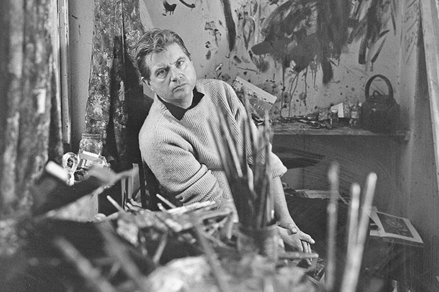 Francis Bacon photographed by Cecil Beaton in 1960 in his studio at Overstrand Mansions in Battersea, London.