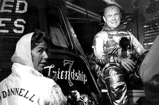 Cece Bibby (left) painting the name 'Friendship 7' on John Glenn's Mercury spacecraft in 1962.