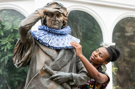 The statue of Christopher Columbus outside Sefton Park Palm House, redressed by the fashion designer Taya Hughes.